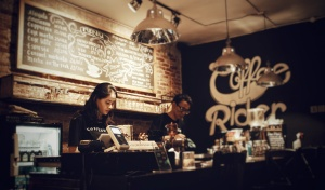 Two workers behind the counter at an independent coffee shop